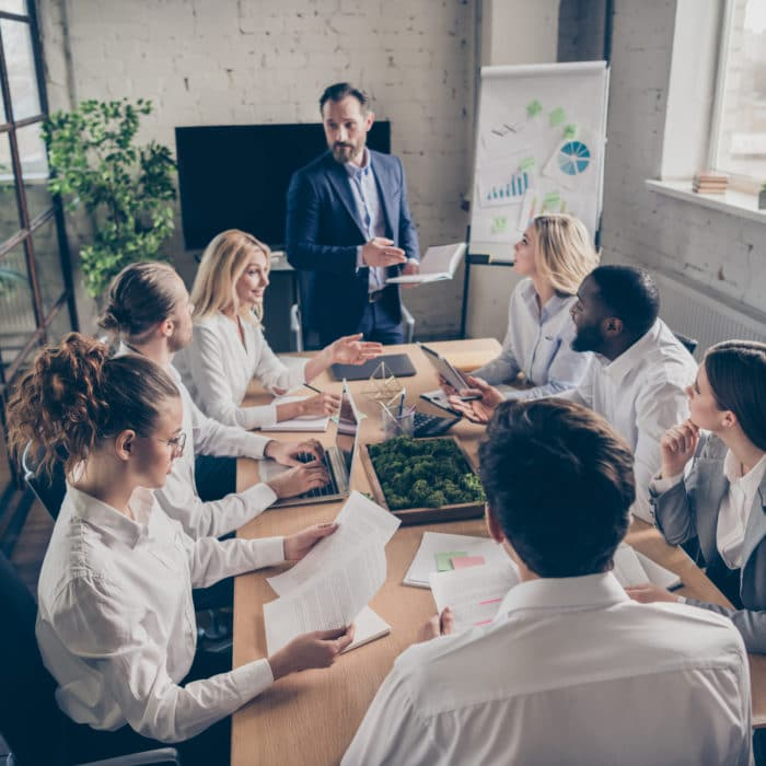 Photo of business people sharks gathering sit table desk listen investor talk company growth way-out crisis strategy in workplace workstation